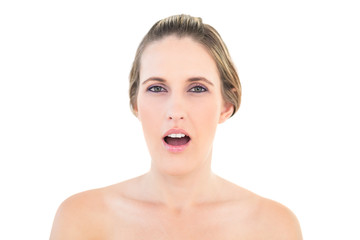 Portrait of shocked woman looking at camera