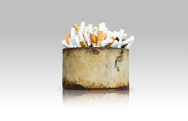 dirty ashtray with cigarette ash and butts
