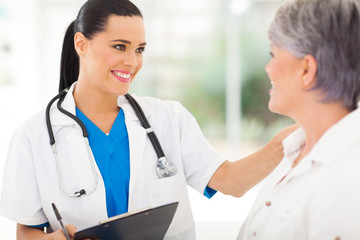 female doctor comforting middle aged patient