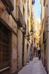 narrow street of Gothic district.  Barcelona
