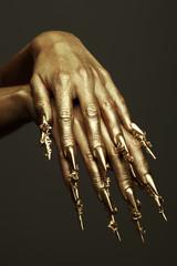 Art Manicure Concept. Golden hands with golden nails