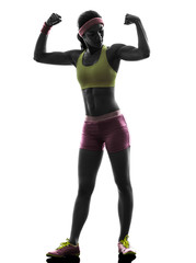 Wall Mural - woman exercising fitness flexing muscles  silhouette