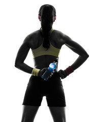 Wall Mural - woman exercising fitness holding energy drink  rear view silhoue