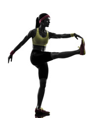 Wall Mural - woman exercising fitness workout  stretching silhouette