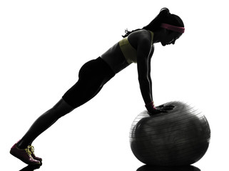 Wall Mural - woman exercising fitness workout push ups  silhouette