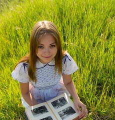 girl looks an album with photos