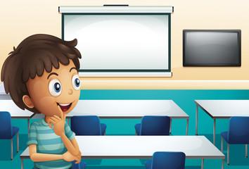 A boy inside a meeting room