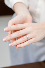 Close up of female hands with engagement ring at jeweler's shop