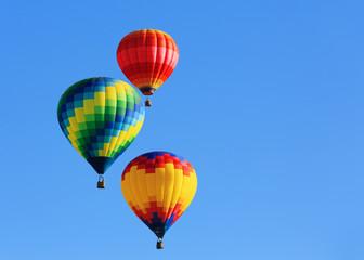 Poster Montgolfière / Dirigeable hot air balloons against blue sky