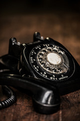 Black vintage telephone on a farm table