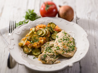 escalope with tomatoes and zucchinis, selective focus
