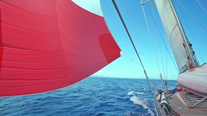 Fototapete - sail blows in the wind on boat in navigation