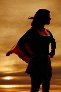 silhouette woman super hero cape