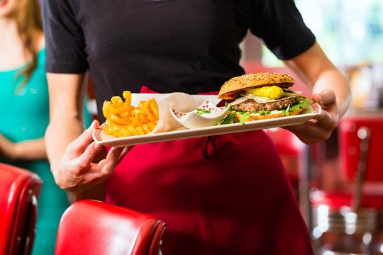 Waitress serving in American diner or restaurant