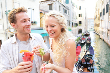 Couple eating fruit snack in Venice