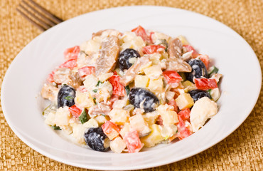 Fresh vegetable salad with mushrooms and olives
