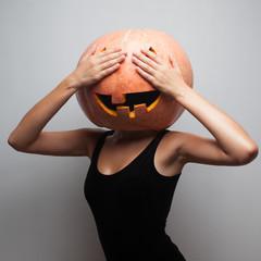 Funny pumpkin face. Dancer in Halloween costume