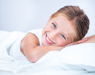 little smiling girl in a bed