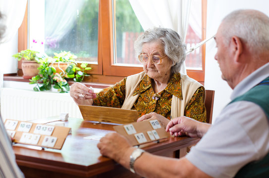 Senior people playing rummy