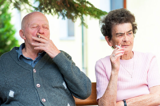 old couple smoking a cigarette