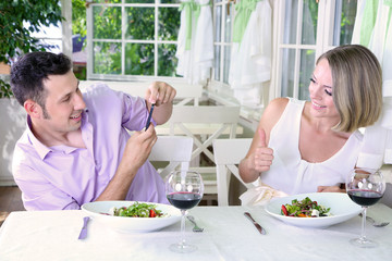 Young couple  taking  photo with  mobile phone in restaurant