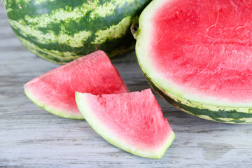 Ripe watermelons on wooden table