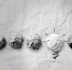 another idea light bulb on crumpled paper as creative concept