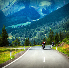 Fototapete - Group of bikers in mountains