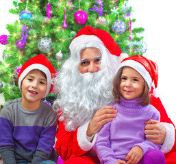 Adorable kids with Santa Claus