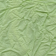 green crumpled sheet of paper
