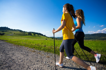 Nordic walking - active people working out outdoor Wall mural