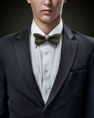 Hansome businessman in suit with bow-tie