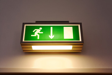 Exit sign on the wall Wall mural