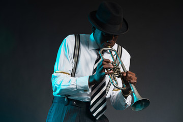 Wall Mural - Retro african american jazz musician playing on his trumpet. Wea
