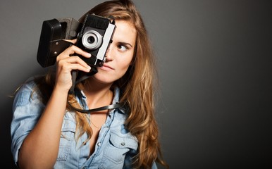 Silly photographer woman with old camera