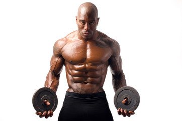 Black bodybuilder posing with round discs