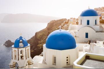 Tuinposter Santorini Blue churches of Oia village and sea at Santorini island, Greece
