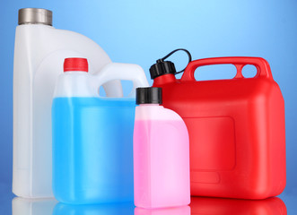 Liquids for car in canisters on blue background