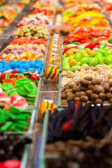 Market stall full of candys in La Boqueria Market.Barcelona