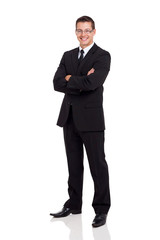 business man in a suit with arms folded