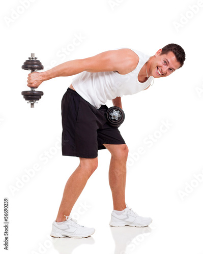 handsome young man using dumbbells stock photo and royalty free