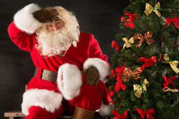 Santa Claus looking tired after delivering all gifts to children