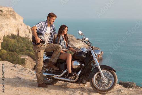 Wall mural Biker man and girl