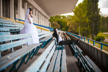 Groom sitting on tribunes and looking on field