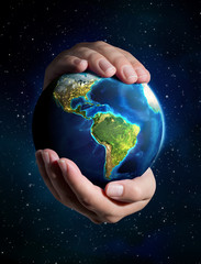 Wall Mural - earth in the hands - Universe background - USA