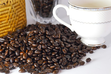 Coffee beans and coffee cup on white backgrond