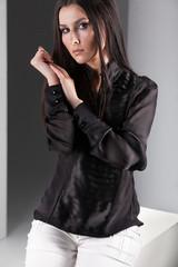 Portrait of sexy brunette in sheer black blouse