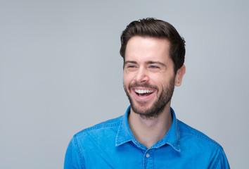 Portrait of a handsome young man laughing