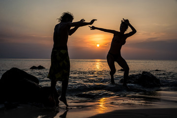 Happy Couple in Love Jumping, Fun. Tropical Island Sunset. Thail
