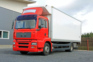 Red Delivery Truck by Warehouse